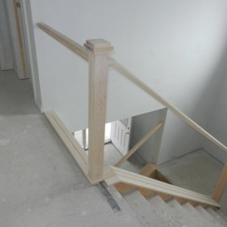 Unfinished wooden railing for glass inserts.