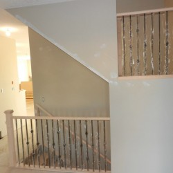 Level shot of stair railing and banister.