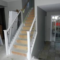 White wood railing with metal spindles.