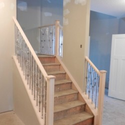 Level shot of wooden and metal railing.