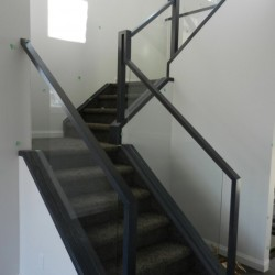 Glass stair railing system.