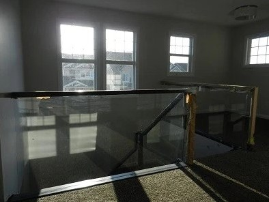 Stair railings with glass inserted.