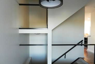 Two-level railing system for glass.