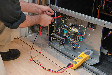 Man working on a heat pump