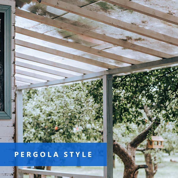 A beautiful pergola installed on top of a wooden patio.