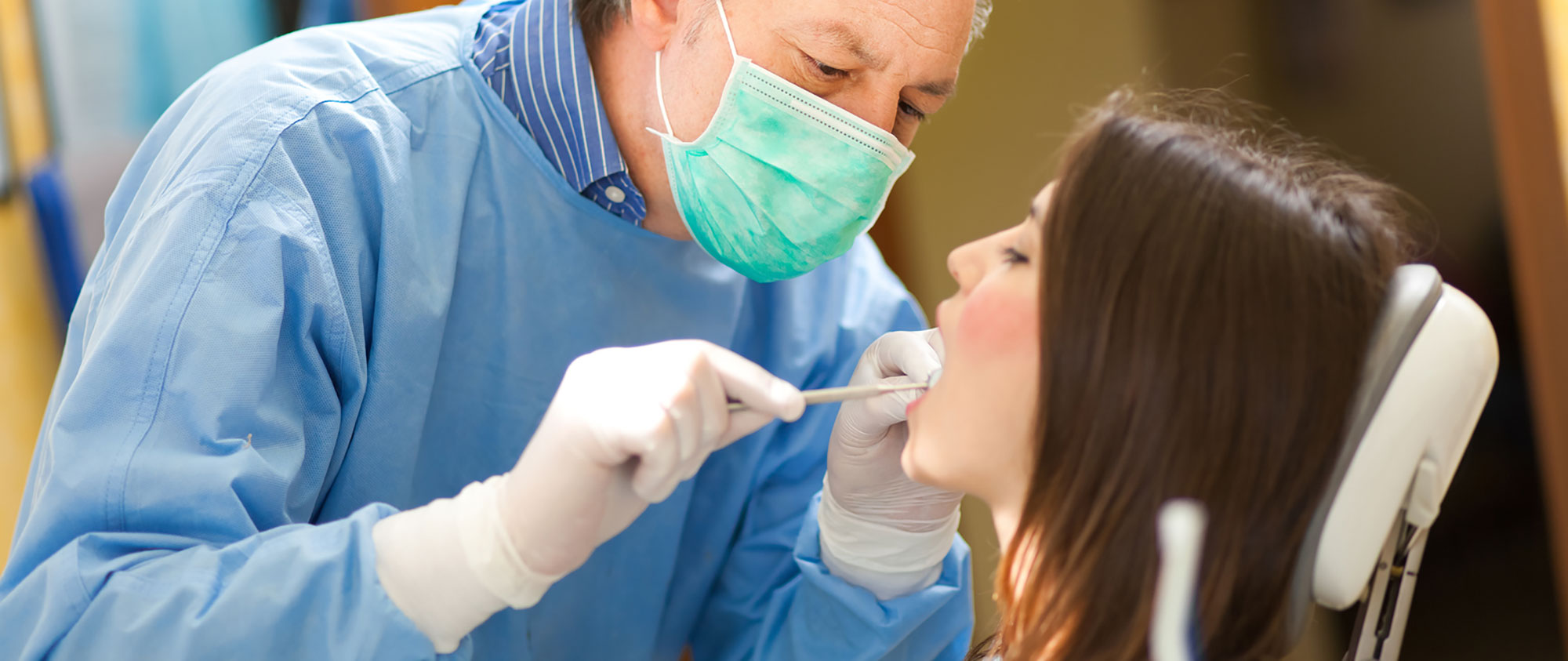 Dentist in Eagan Checking patients teeth.