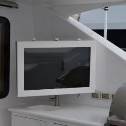 A close up image of a water proof television case built by Dennis Boatworks.