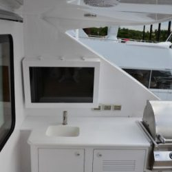 Image of a custom built waterproof television case and mount on the deck of a yacht.