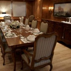 Image of 10-person dining table with custom interior created by Dennis Boatworks.