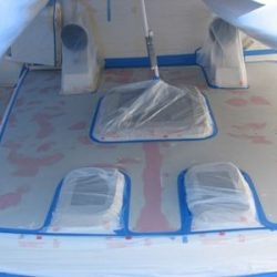 Photo of the flooring on the deck of a yacht being remodeled.