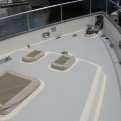 An image of newly remodeled deck on the bow of a yacht with new flooring.