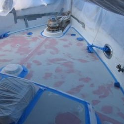 Photo of the deck of a yacht in the process of being remodeled.