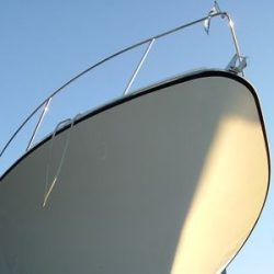 An image looking up from the water of the bough of a yacht that Dennis Boatworks has worked on.