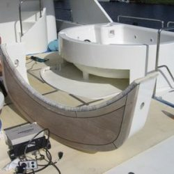 An image of a custom countertop in the process of being built by Dennis Boatworks to surround the circumference of a jacuzzi.