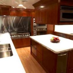 Image of spacious, wooden, luxury kitchen created by Dennis Boatworks.