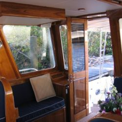 Image of wooden door and furnished interior designed by Dennis Boatworks.