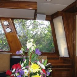 Image of windows and blinds from inside a room on a yacht designed and built by Dennis Boatworks.