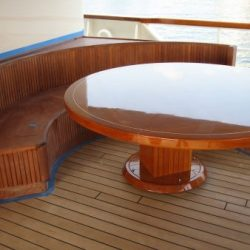 An image of a custom made circular dining booth by Dennis Boatworks.