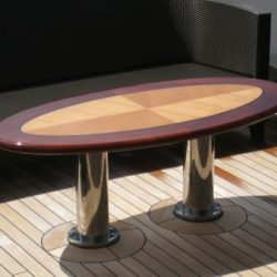 An image of a custom wooden outdoor table made by Dennis Boatworks.