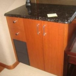 Image of custom crafted cabinet with counter top by Dennis Boatworks.