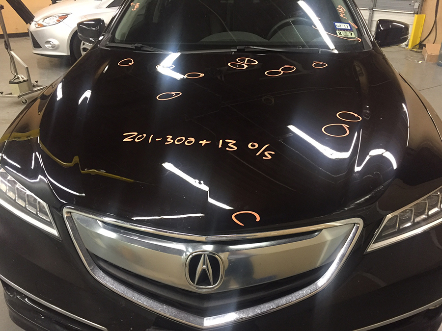 Paintless dent repair of an Acura