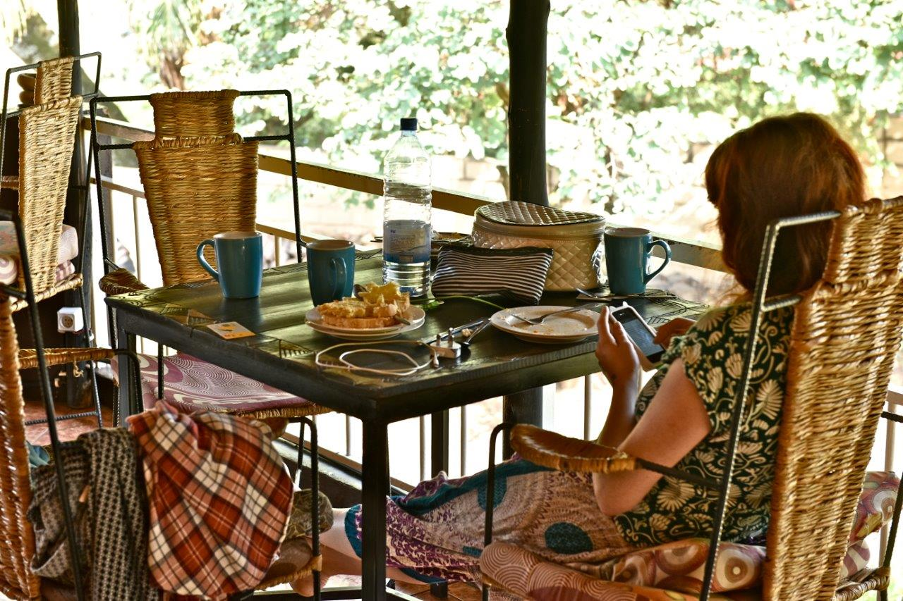 Relaxing in our cozy veranda enjoying Rwandan Breakfast