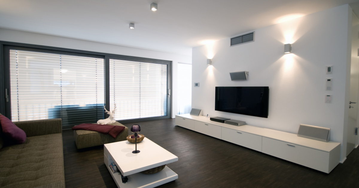 A picture of a living room with an attractive lighting display.