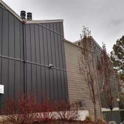 Multi-family building with new gray James Hardie ColorPlus siding - DJK Construction