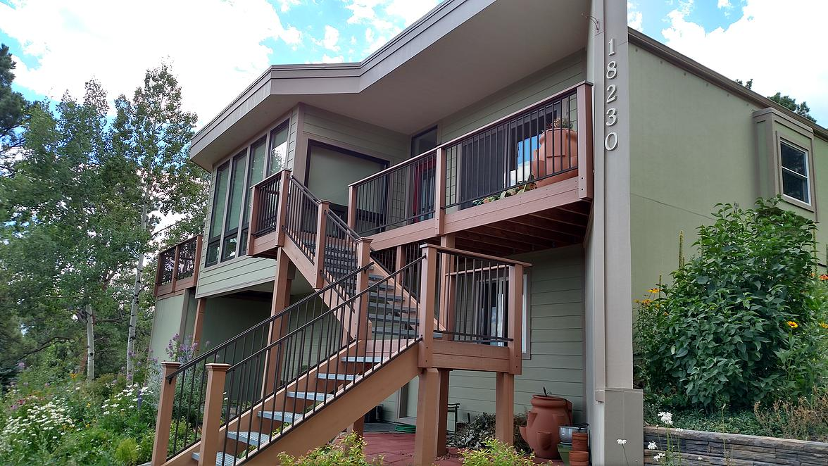 Back yard deck stairs and lap and panel siding - DJK Construction