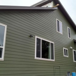 Home's garage and dark gray lap siding - DJK Construction