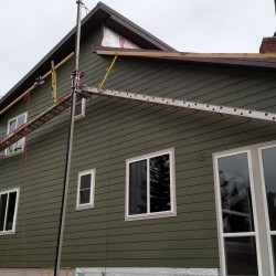 Home with new green lap siding - DJK Construction