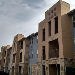 Multi-family siding installation using James Hardie Fiber Cement Stucco panels - DJK Construction