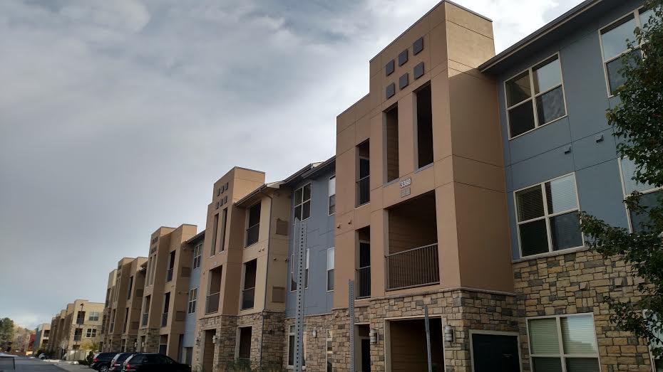 Multi-family siding installation using James Hardie Fiber Cement Stucco panels - DJK Construction
