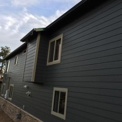 Dark gray lap siding with boral cultured stone - DJK Construction