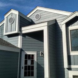 Home with James Hardie Colorplus dark gray-blue siding and white trim - DJK Construction