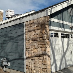 Home's lap siding with stone accents - DJK Construction