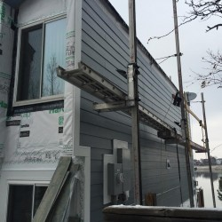 New siding installation using James Hardie Colorplus lap siding - DJK Construction