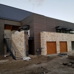 Modern home with pre-stained siding - DJK Construction