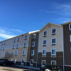 Hotel siding installation using lap siding - DJK Construction