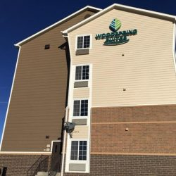 Siding installation at Woodspring Suites - DJK Construction