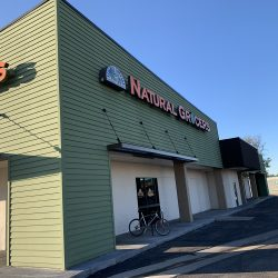 New green commercial siding installation at Natural Grocers - DJK Construction