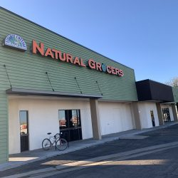 Green commercial siding installation at Natural Grocers - DJK Construction
