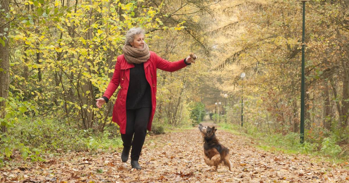 Image of a happy woman in fall foliage.