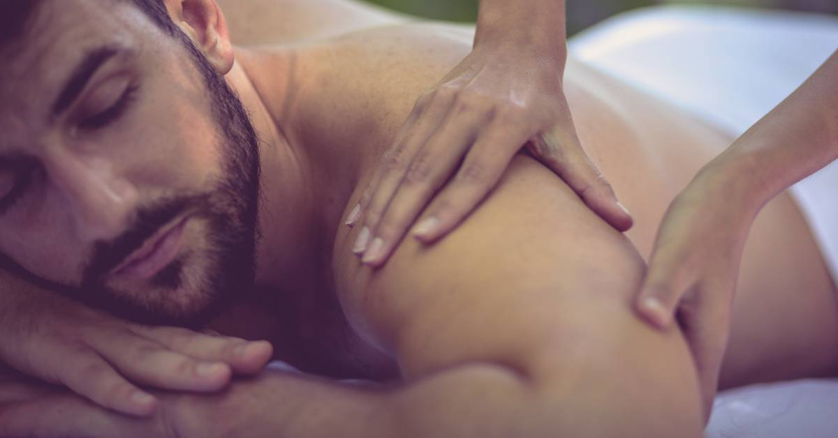 An image of a relaxed man getting a massage.