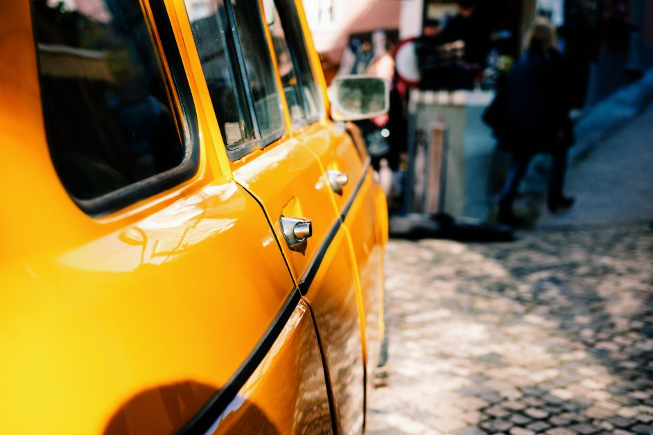 An image of a yellow car in the sun.