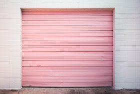 An image of a pink garage door.