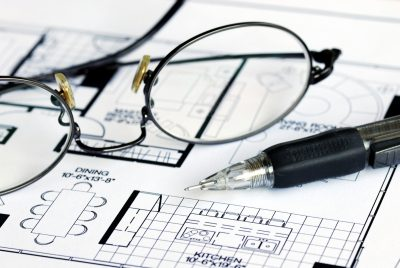 Glasses on Blueprint Floorplan Closeup