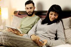 woman-bed-texting-message-boyfriend-jealous-looking-happy-girl-47994707