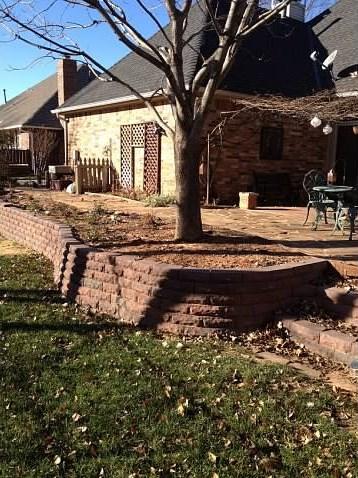 Flagstone patio and retaining wall
