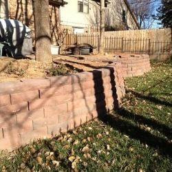 Lawn care and retaining wall